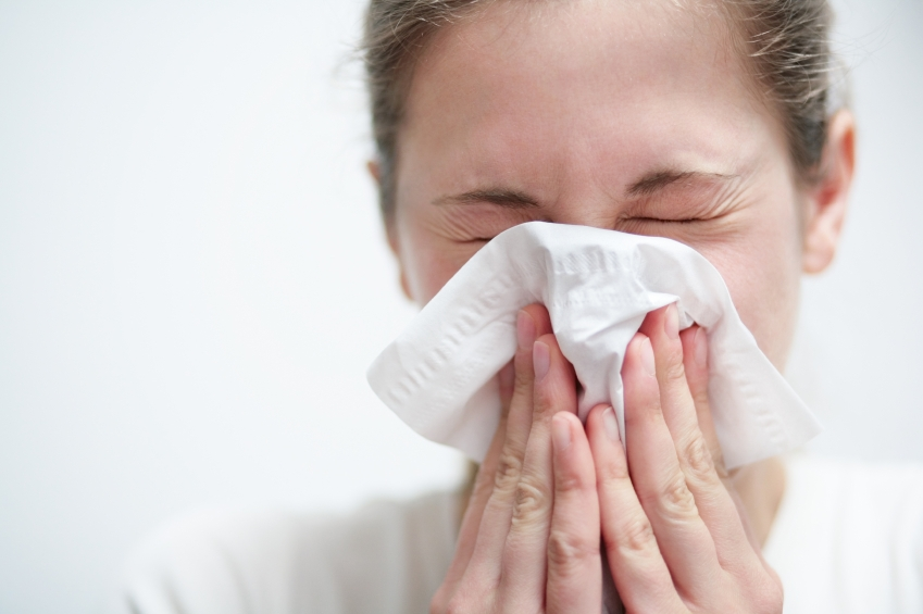 Woman Blowing Nose Tissue