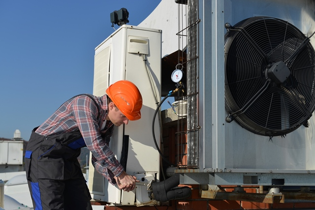 Worker Replacing Air Conditioning