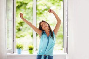 Woman Stretching Window