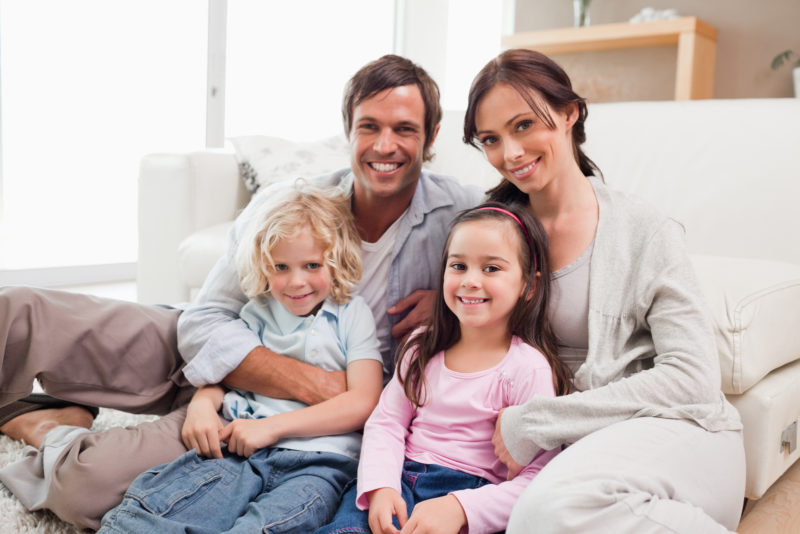 Family Smiling Couch Living Room