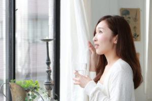 Woman Looking Window