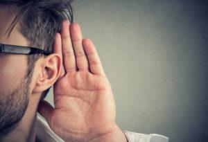 Man Cupping Ear Listening
