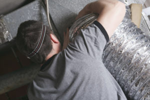 Man Sealing Duct