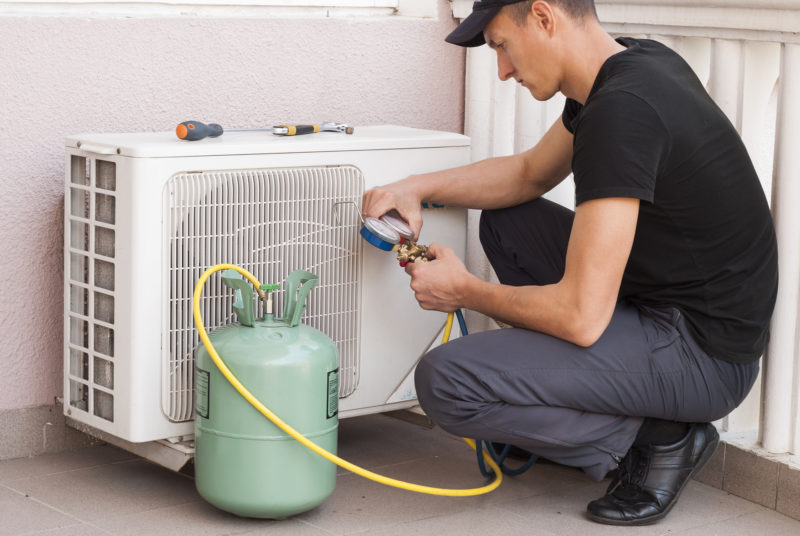 Man Checking Air Conditioning System