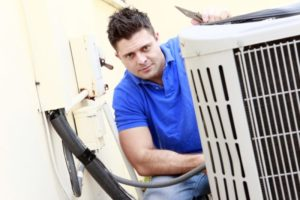 Man Checking Air Conditioner AC